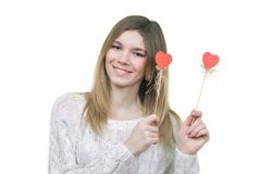 Beautifull woman holding hearts smiling Stock Photos