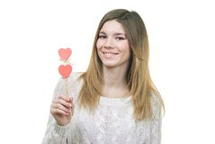 Beautifull woman holding hearts smiling Royalty Free Stock Photography
