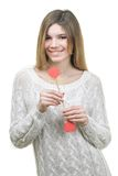 Beautifull woman holding hearts smiling Stock Photography