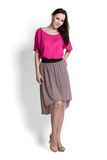 Beautifull woman in pink blouse and beige skirt Royalty Free Stock Image