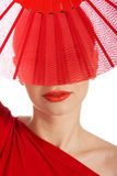 Beautifull woman in sexy red dress with fan. Royalty Free Stock Images