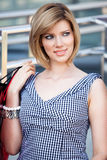 Beautifull woman with shopping bags. Beautiful blond with shopping bags near supermarket royalty free stock photos
