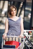 Beautifull woman with shopping cart Stock Photos