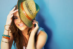 Beautifull woman with straw hat smiling and happy Royalty Free Stock Image