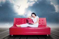 Beautifull woman using laptop on couch Stock Photos