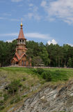 Beautifull wooden christian orthodox church on the bank of the r Royalty Free Stock Photos