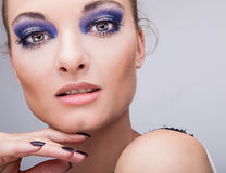 Beautifull young blond model with blue make-up. Close-up eyes. Natural health beauty of a woman face Stock Images