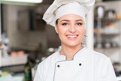 A beautifull young female chef posing for camera Royalty Free Stock Photo