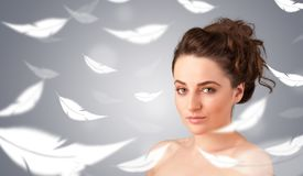 Beautifull young girl with light feather skin concept Stock Photo