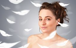 Beautifull young girl with light feather skin concept Royalty Free Stock Photos