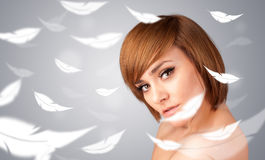 Beautifull young girl with light feather skin concept Royalty Free Stock Photography