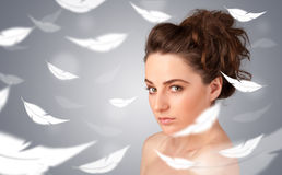 Beautifull young girl with light feather skin concept Royalty Free Stock Images
