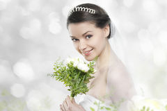 Beautifull young woman as bride. With tiara and flower bouquet royalty free stock photography