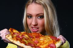 Beautifull young woman eating pizza Stock Photo
