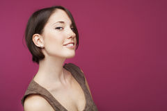 Beautifull young woman on pink background Stock Photography