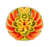 Beautifully arranged fruit plate. Fruit plate with oranges, kiwis and mandarins nicely arranged royalty free stock photo