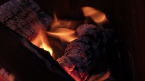 Beautifully burning logs in the grill stock photography