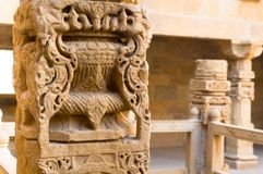 Beautifully carved ancient sandstone pillar. With more pillars in the background. The amazing carving ine the Jaisalmer fort in Rajasthan make this an amazing Royalty Free Stock Photography