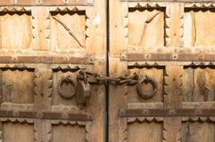 Beautifully carved gate with chain and lock restricting access. Beautifully carved wooden gate with chain and lock restricting access to the inside Stock Photos