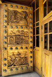 A beautifully carved wooden door on the Basilica of Our Lady of Copacabana, the famous Catholic church in Copacabana in Bolivia. Stock Photos