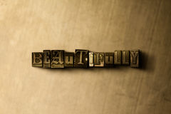 BEAUTIFULLY - close-up of grungy vintage typeset word on metal backdrop Stock Photography