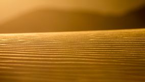 Sunset on sahara desert sand dunes in morocco Royalty Free Stock Image