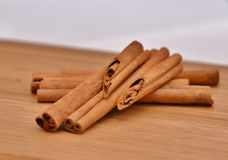 Beautifully composed of cinnamon sticks. On a wooden board Stock Photography