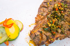Beautifully cooked cutlet with chimichurri topping Royalty Free Stock Images