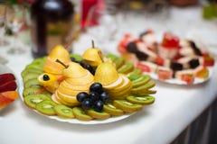 Beautifully cut fresh fruit, on the holiday table. Beautifully cut fresh fruit on the holiday table stock photo