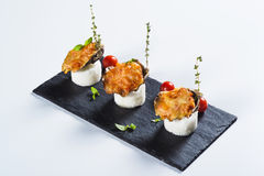 Beautifully decorated  baked oyster with cheese on plate Stock Images