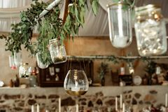Banquet. candle and branch decoration with leaves stock image