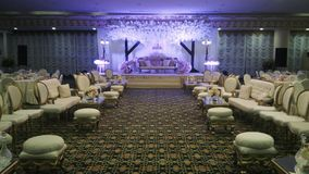 Beautifully decorated banquet hall for wedding reception stock photo
