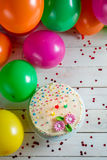 Beautifully decorated birthday cake with lighted candles Royalty Free Stock Photography
