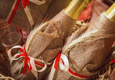 Beautifully decorated bottles of champagne. Decoration in the autumn style royalty free stock photo
