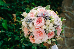 Beautifully decorated bouquet closeup with white and pink roses, sky flowers. Beautifully decorated bouquet closeup in vase, with white roses ang green leaves Stock Photography