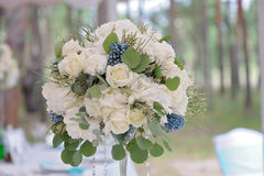 Beautifully decorated bouquet closeup with white roses. Beautifully decorated bouquet closeup in vase, with white roses ang green leaves Royalty Free Stock Photo