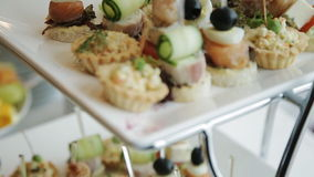 Beautifully decorated buffet table Canapes stock footage