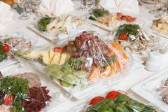Delicacies and snacks in the buffet. Seafood. A gala reception. Banquet. Catering stock photos
