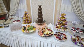 Beautifully decorated catering banquet table with different food on corporate christmas birthday party event or wedding. Celebration stock footage