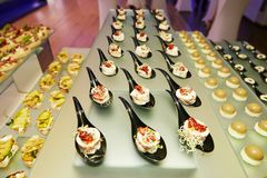Beautifully decorated catering banquet table with different food stock photography