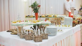 Beautifully decorated catering banquet table with different food snacks and appetizers on corporate christmas birthday