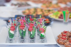 Beautifully decorated catering banquet table with different food snacks and appetizers Stock Images