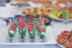 Beautifully decorated catering banquet table with different food snacks and appetizers Royalty Free Stock Image