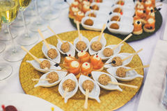 Beautifully decorated catering banquet table with different food snacks and appetizers Royalty Free Stock Images