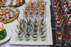 Beautifully decorated catering banquet table with different food snacks and appetizers Royalty Free Stock Photo