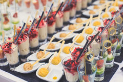 Beautifully decorated catering banquet table with different food snacks and appetizers Stock Image