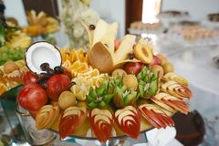 Beautifully decorated catering banquet table with different fresh fruits on corporate birthday party event or wedding celebration. stock images