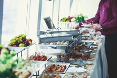 Beautifully decorated catering banquet table with variety of different food snacks and appetizers on corporate christmas birthday Royalty Free Stock Photography