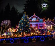 Beautifully decorated Christmas house with million different lights and Bethlehem Star at the top. Gorgeously decorated for the Christmas holiday house with Stock Photos