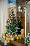 Beautifully decorated Christmas tree with many presents under it. Stock Photos